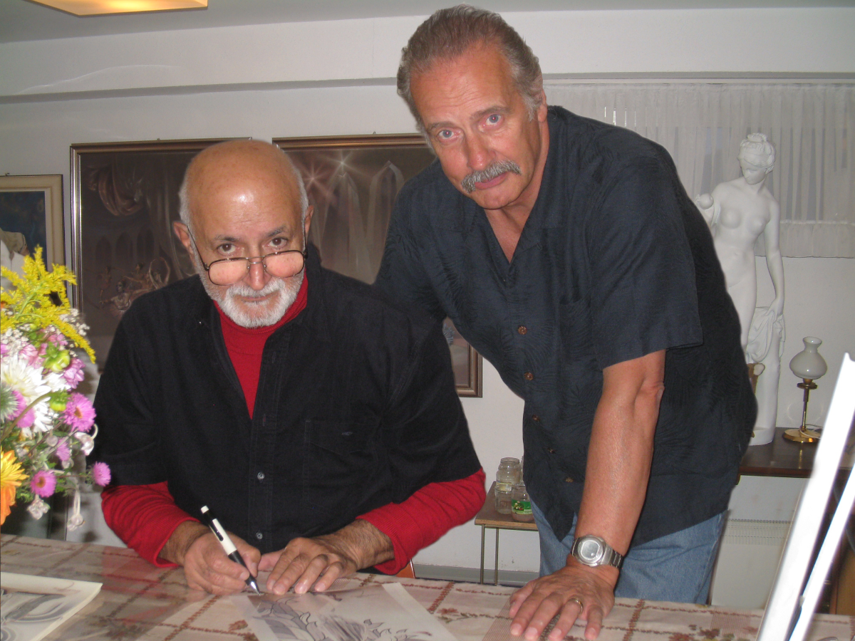 Bijan signs his archived prints, watched by John